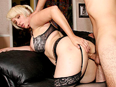 Blonde milf Gina De Palma in sexy black lingerie slurps cock and takes pussy pounding on a couch