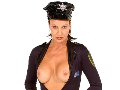 Busty milf in uniform Vanessa Videl posing and showing off her huge pair of melons